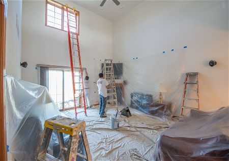 Ladders in interior residential painting with high ceilings in Rio Rancho New Mexico